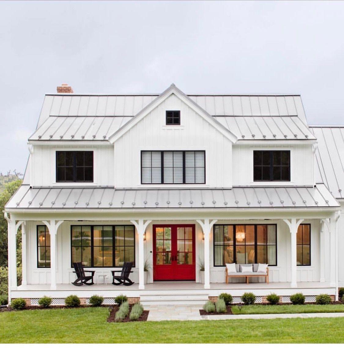White exterior, light grey metal roof, bright red door