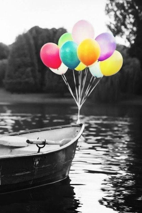 On A Pretty Lake, In A Boat, With Colorful Balloons.