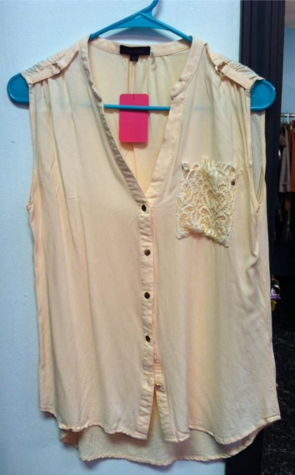 Lulumari size L $10.00. In store only or contact us on Facebook
