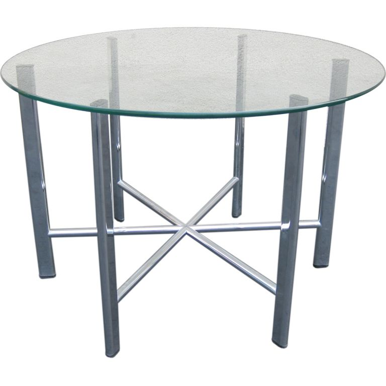 1970s Chrome and Glass Round Coffee or End Table | $750  HEIGHT: 20 in. (51 cm) DIAMETER: 30 in. (76 cm)
