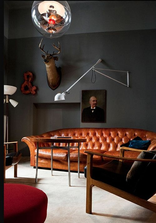 Masculine Living Room With Dark Grey Walls Warm Leather Chesterfield Sofa Midcentury Chair
