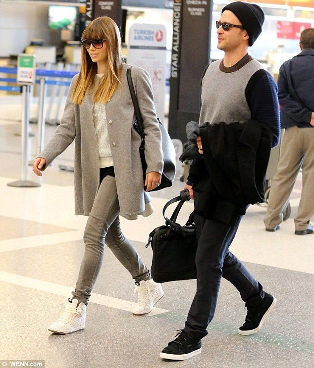 848dc7a82c24 Jessica Biel and Justin Timberlake coordinate with monochrome outfits for  airport arrival