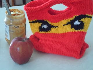 If you can't find it - make it. Knitted ninjago eyes lunch bag with link to pattern.