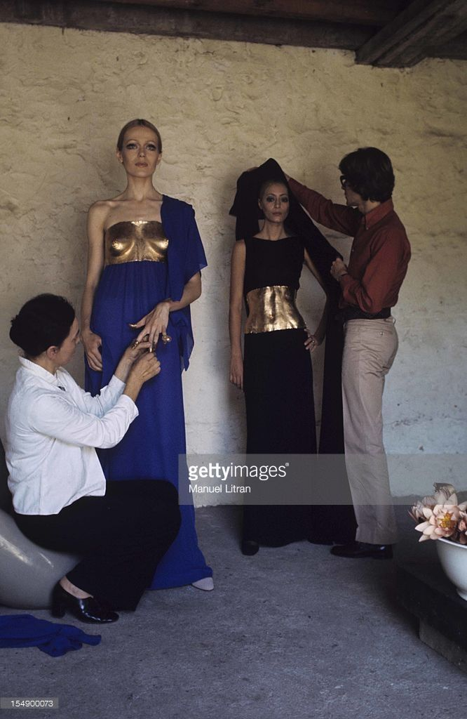 With the evening gowns of his winter collection, Yves Saint-Laurent emphasizes the sculpted body of the woman, He dresses her nylons molded around objects that Claude Lalanne carved from the imprint of the body, Right, the fashion designer Yves SAINT LAURENT adjusts the veil of a dummy .