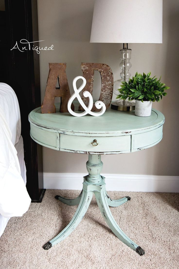 large drum table chalk painted in a light aqua! shabby chic decor
