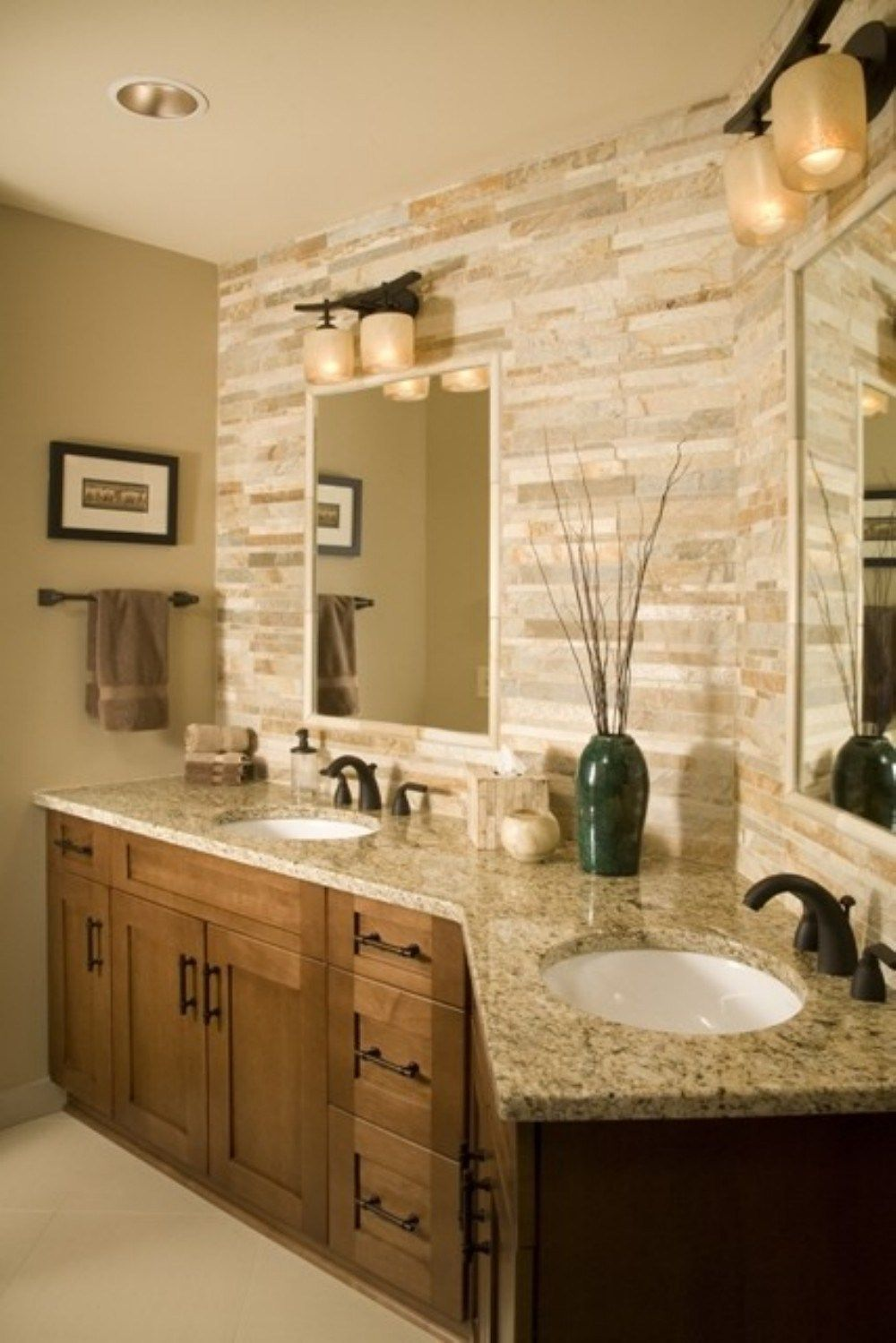 Love the tile on wall behind the sinks. Goes so well with the ...