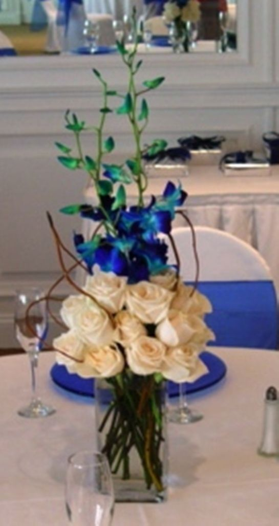White roses blue orchids centerpiece this was the