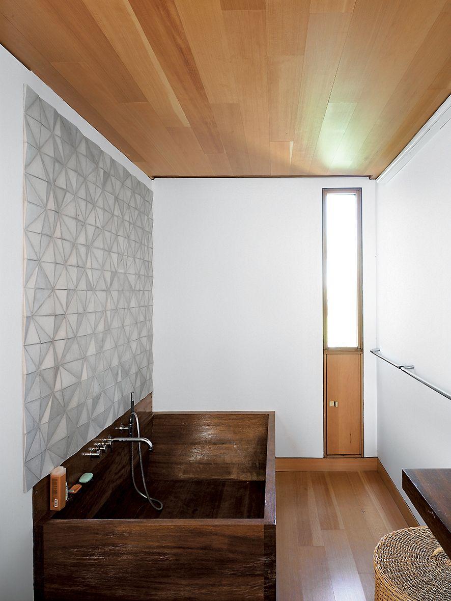 In the bathroom a custom ceramic backsplash