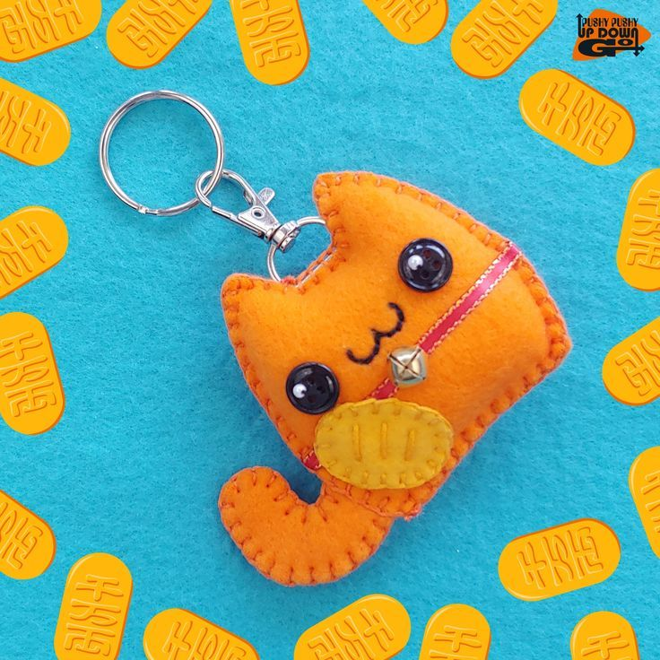 """Need a bit of extra luck? Why not make it cute while you're at it with a Kawaii Orange Maneki Neko Cat Plush Keychain & Bag Charm! Whether you're a cat lover, a kawaii lover, or a bit of both, these handmade lucky cat charms are here to put a smile on your face. Meaning """"beckoning cat,"""" maneki neko are common figurines from Japan that are believed to bring good luck. The colors of the cats have different meanings as well. Orange maneki neko are supposed to help bring safe and enjoyable travels."""