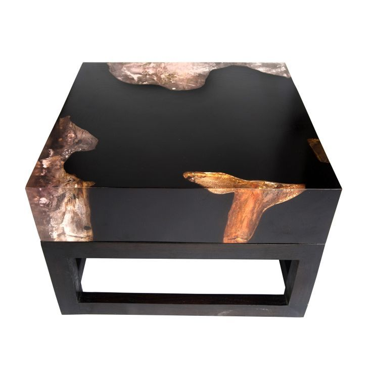 This modern black coffee table is filled with cracked amber resin.  Resin breaks charts in 2017 for trending interior design materials.  It allows you to use reclaimed wood that has gashes or flaws.  Try this winner in your Rising Barn. Stimulate the senses.  Risingbarn.com  #coffeetable #unique #resin #reclaimedwood #black #amber #modern #2017 #design #trend #beautiful #luxurious #sophisticated