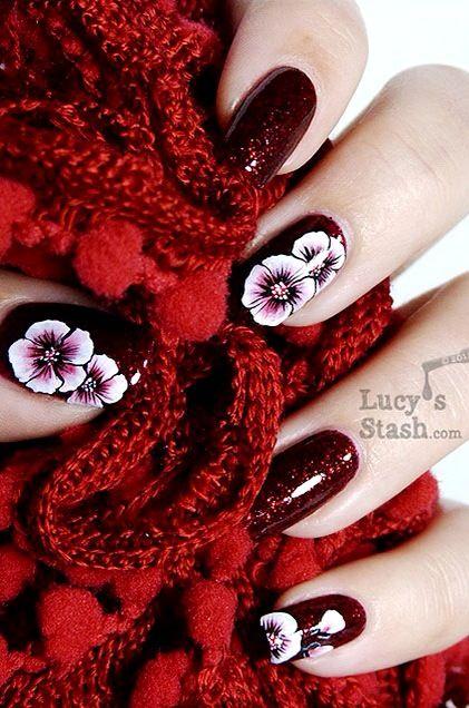 Pretty dark red nail polish art design..