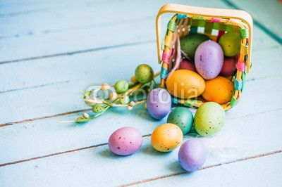 Easter eggs in the basket on blue wooden background - free graphics week beginning 7th March