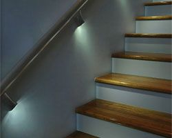 Monopoints or puck lights under hand rail to light stairs ...