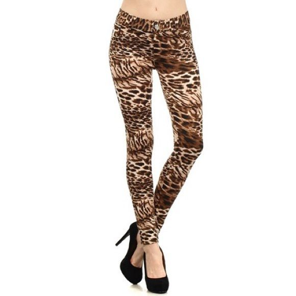 Downtown Leopard Print Stretch Cotton Jegging S/M Downtown Leopard Print Stretch Cotton Jeggings, S/M A bold and daring leopard print in ombré shading brings sultry downtown style to a stretch jegging fitted with 5 pocket with button and fly zip closure on front and belt loops...95% Cotton, 5% Spandex. Pants Leggings