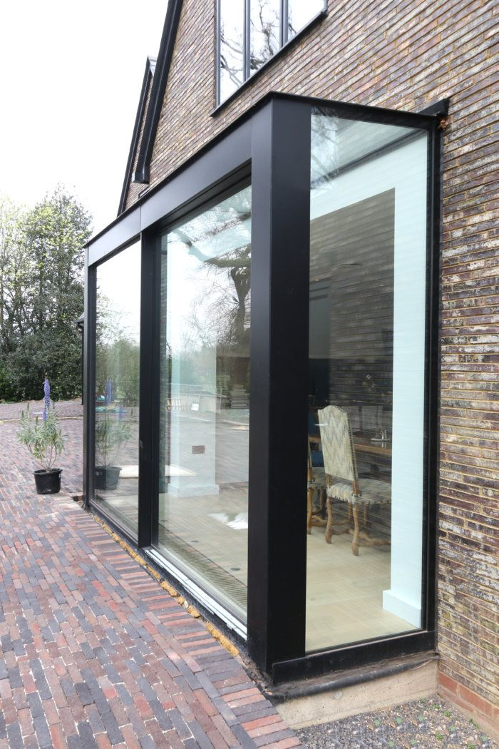 Exterior View Of Sliding Glass Doors With Structural Glazing