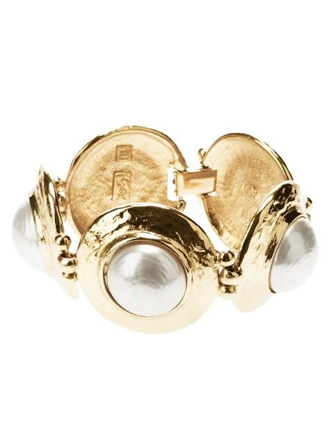 b60c87146f1 Gold-tone bracelet from Yves Saint Laurent Vintage featuring chunky convex  disks with central faux