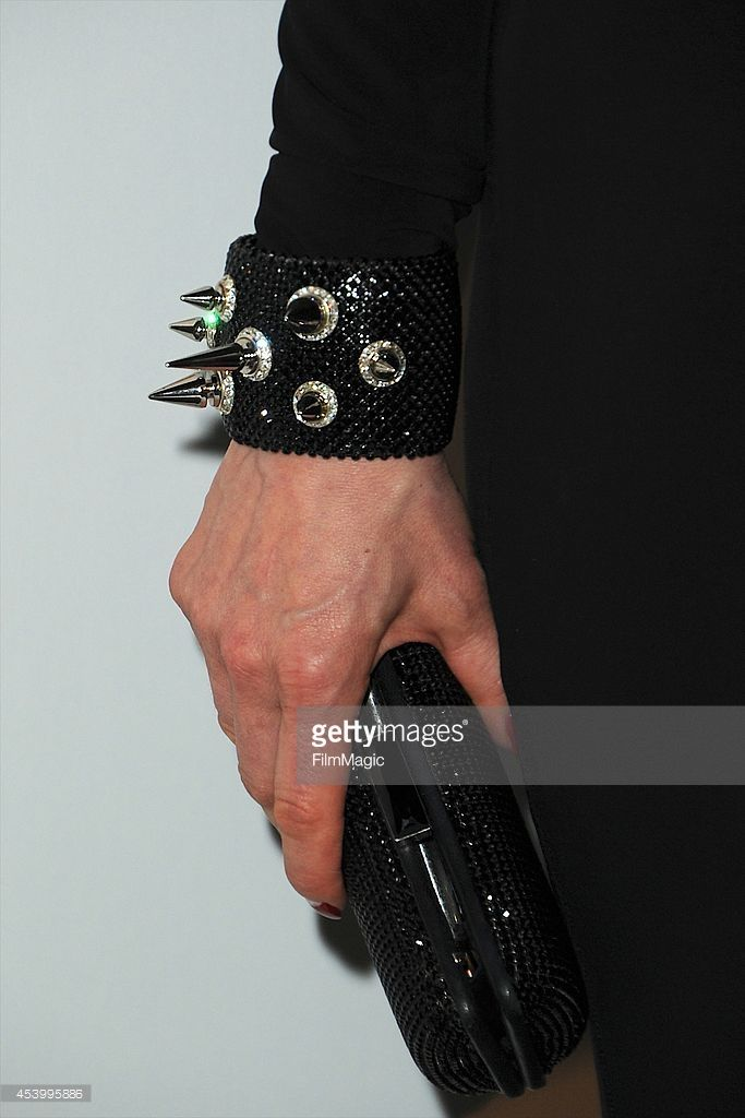 Dita Von Teese (cuff and handbag detail) arrives at the SLS Las Vegas grand opening on August 22, 2014 in Las Vegas, Nevada.