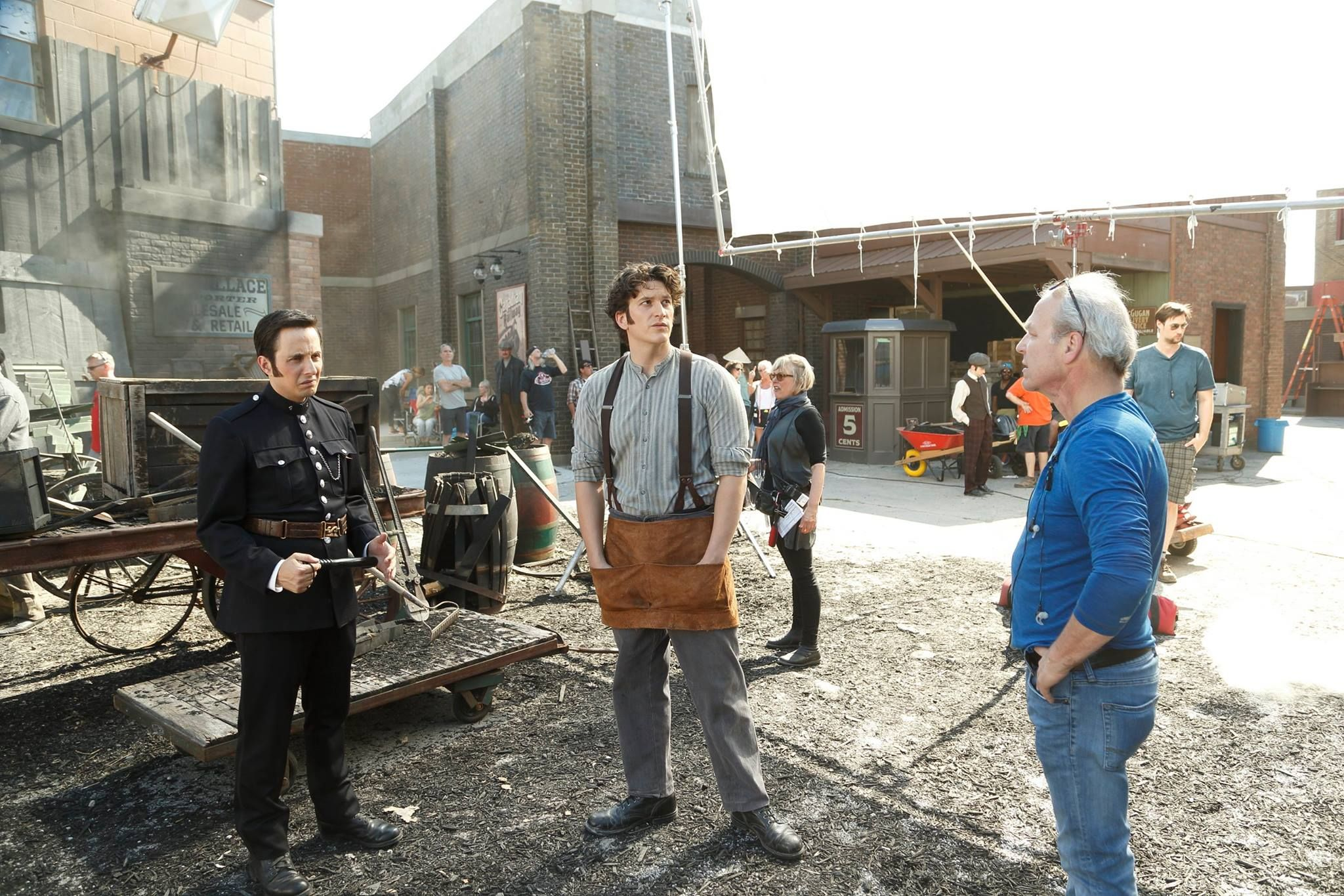 Director Gary Harvey Right Sets Up The Next Scene With Jonny Harris Crabtree Left And Sean Connolly Murdoch Mysteries Murdock Mysteries Detective Shows