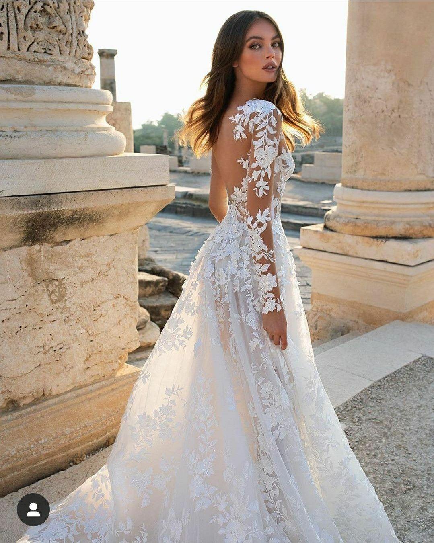 A Line Long Sleeve Floral Lace Wedding Dress With Plunging V Neckline Kleinfeld Bridal Pnina Tornai Wedding Dress Spring Wedding Dress Floral Lace Wedding Dress [ 1351 x 1079 Pixel ]