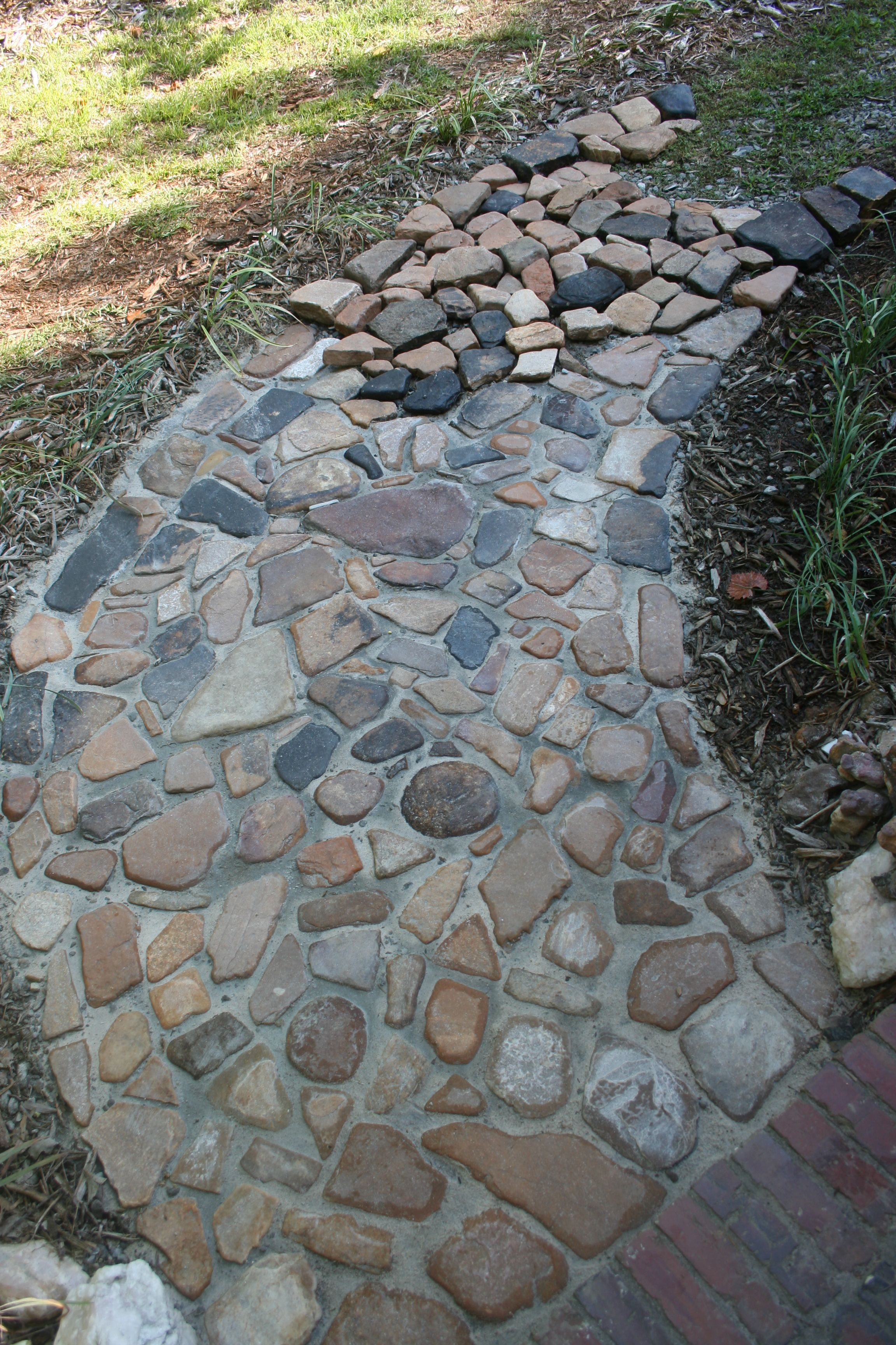 River rock pathway google search landscaping more for How to build a river rock patio
