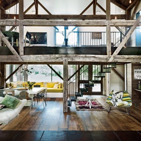 Barn Conversion Contemporary Open Plan Sits Within Original Timber Structure Amazing Staircase And Balustrade Barn Living Timber Frame House Home