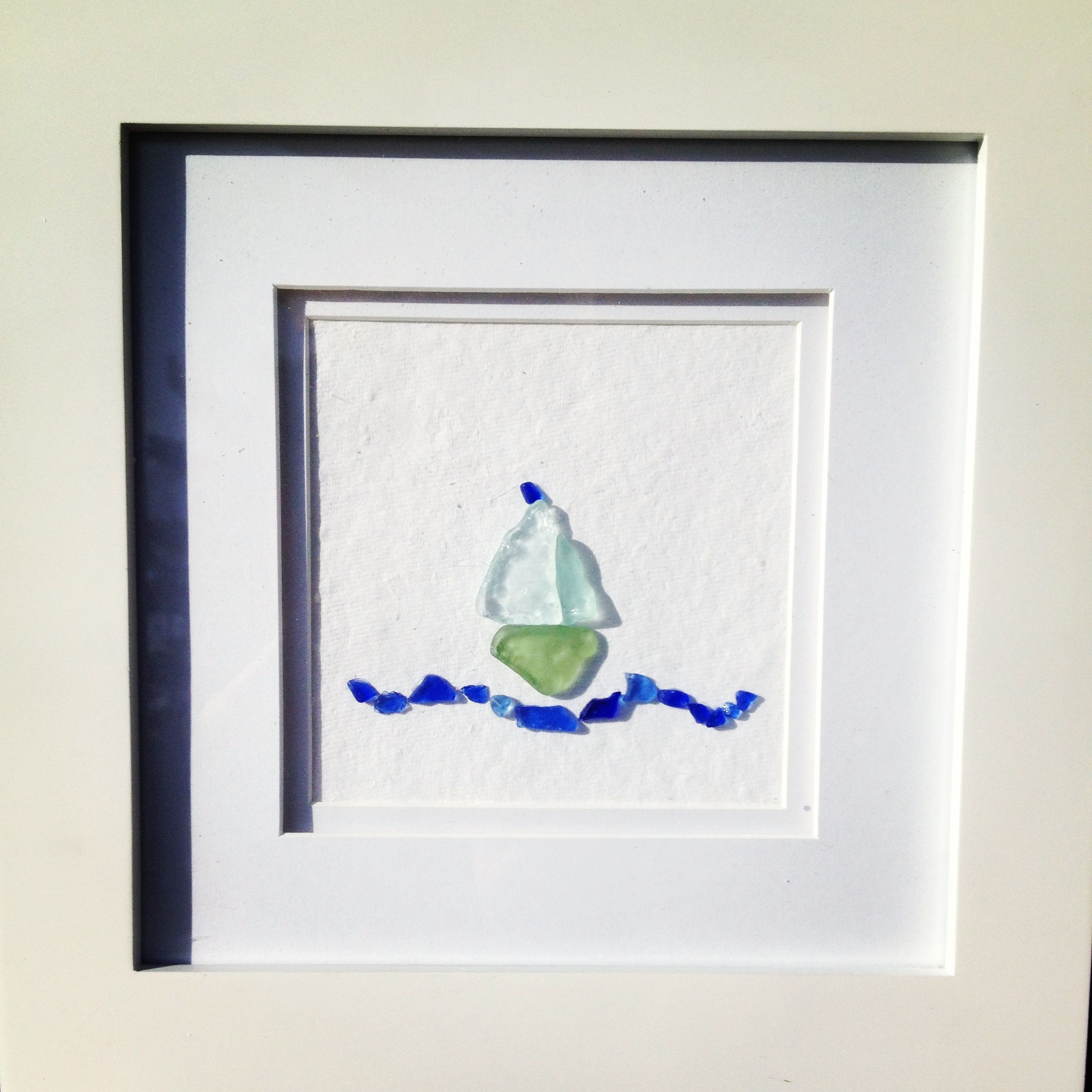 Framed Beach Glass The Frame Was The Hardest To Find But Finally Found The Perfect Frame At Michaels Glued The Be With Images Beach Glass Crafts Pebble Art Sea Glass Art