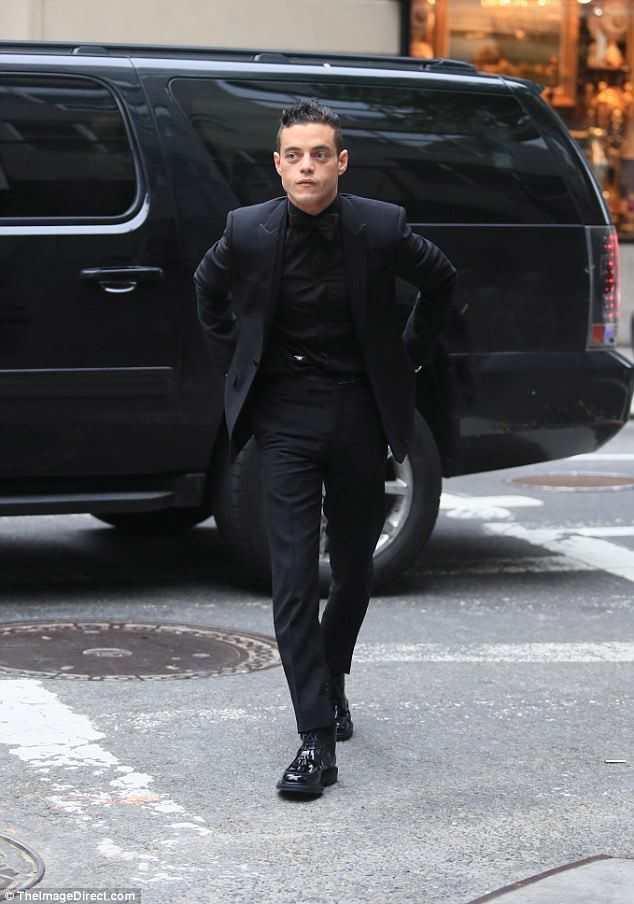 Looking good: Mr. Robot star Rami Malek went with an all black suit as he went to congratu...