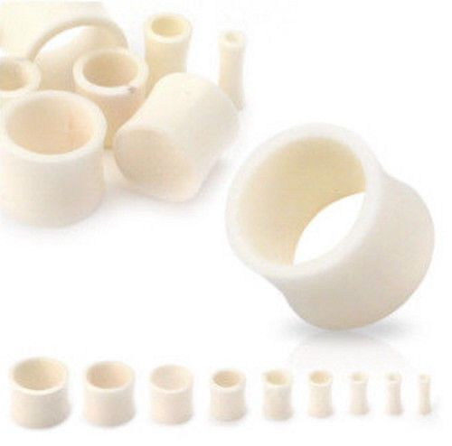 Pair Of Organic Bone Saddle Plugs
