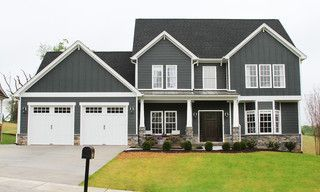 Really Dark Grey Siding With White Trim And Black Roof