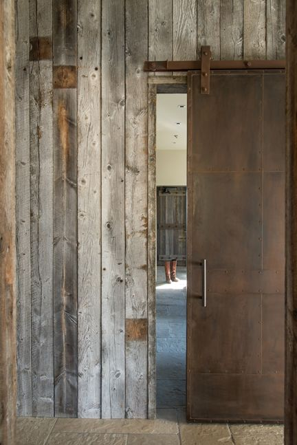 Rusted steel sliding barn door and old wood reclaimed for Metal barn doors