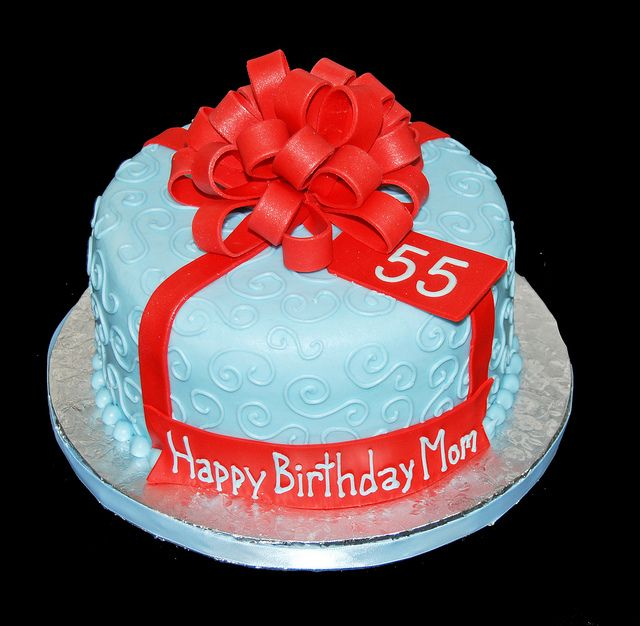Light Blue 55th Birthday Cake Topped With A Large Red Bow By Simply