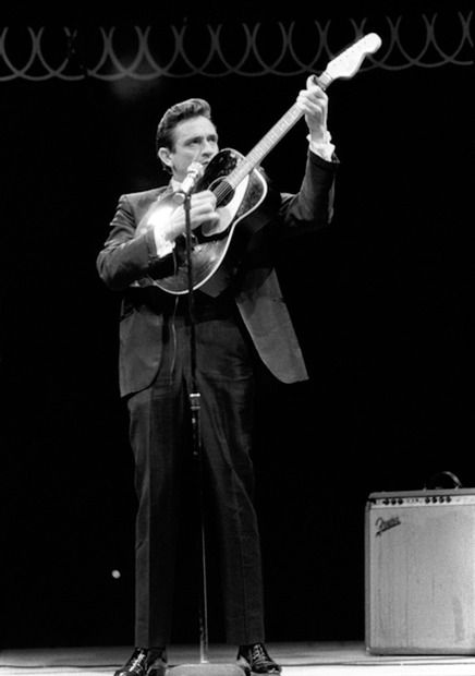 Johnny Cash with a guitar, Circle Star Theatre, Redwood City, CA, 1967. Photo by Baron Wolman.