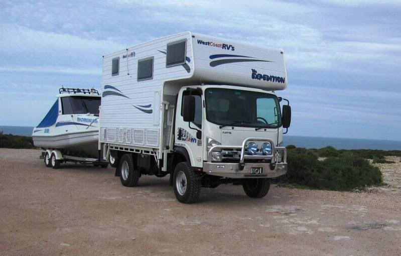 Isuzu NPS 300 Four Wheel Drive Custom Truck Camper | Truck