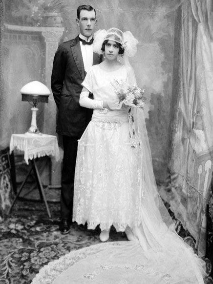 Bride and groom pose vintage wedding 1920s dress and