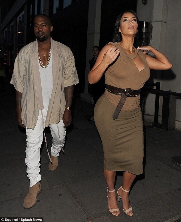 Pregnant Kim Kardashian Flaunts Her Ample Assets In Ripped T Shirt
