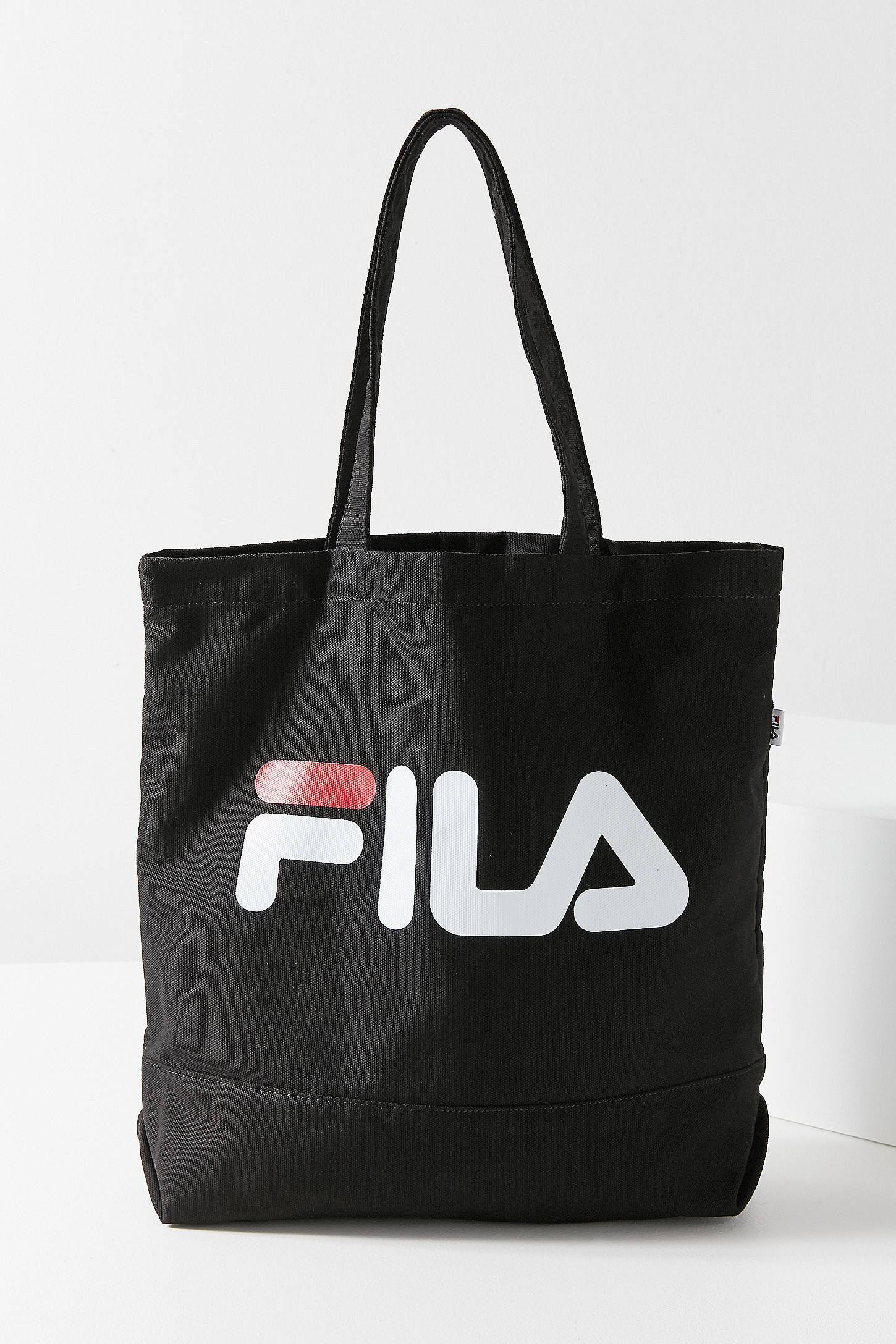 Shop FILA Canvas Tote Bag at Urban Outfitters today. We carry all the  latest styles f8f7537291e3