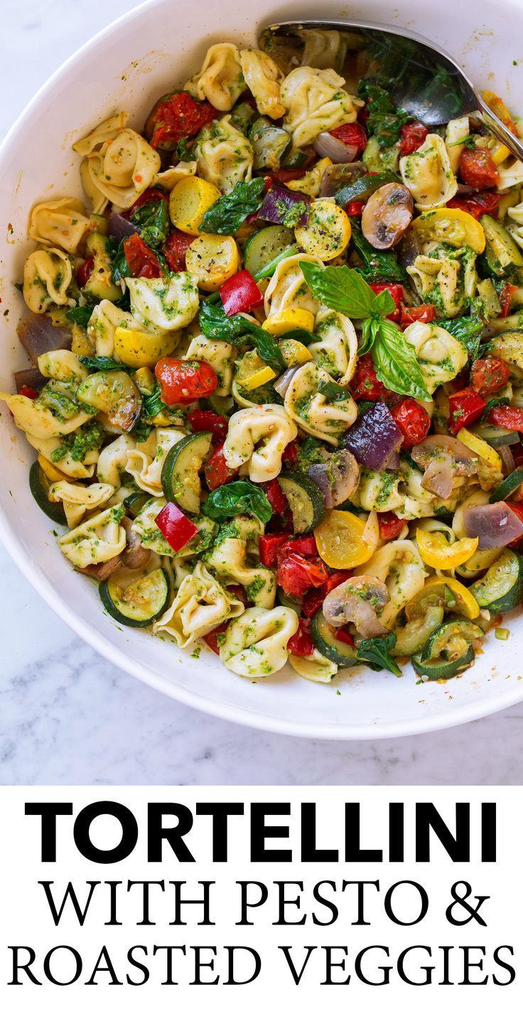 Tortellini with Pesto and Roasted Vegetables - A great way to eat lots of veggies at once! Store bought four cheese tortellini is tossed with bright flavorful pesto and a variety of colorful roasted veggies. A delicious, easy dinner you'll want to make again and again! Preferably boil tortellini during last 7 minutes of veggies roasting so they'll both finish and be warm at the same time.