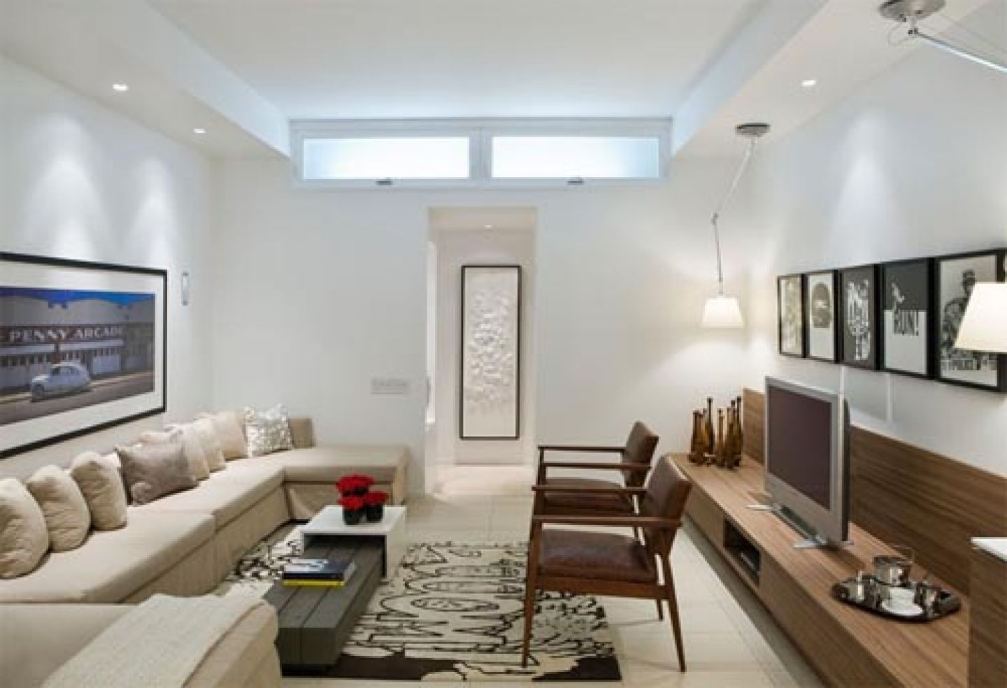 Minimalist Open Living Room Design With Beige Sofa And White Wall ...