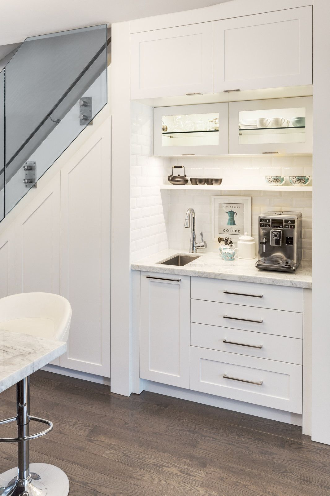 Example of a small trendy singlewall dark wood floor open concept