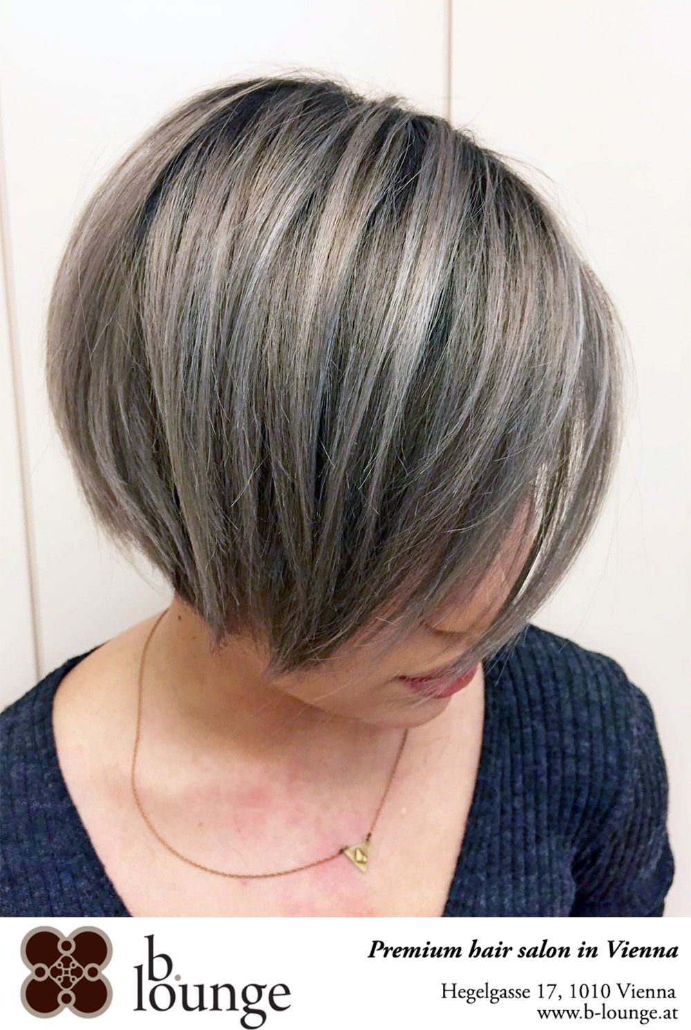 Grey smooth long bob with highlights. Hair colour trend 11