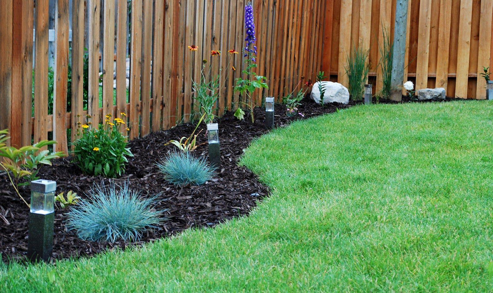 backyard flower bed designs along fence line | back yard design
