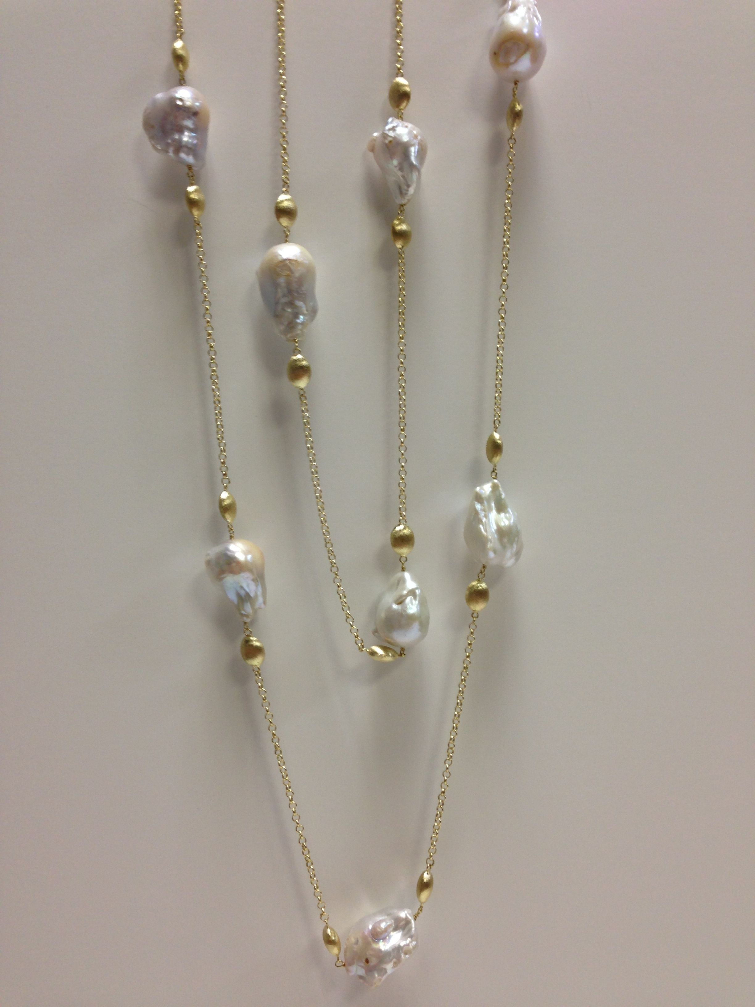 Long yellow gold and baroque pearls. More varieties available in store! Available at www.yanina-co.com, 800-780-3433.