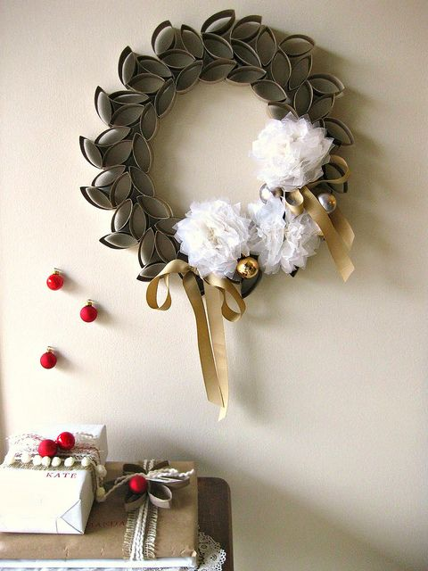 toilet roll wreath:   TO be green with my scouts we will use grocery bag pom poms