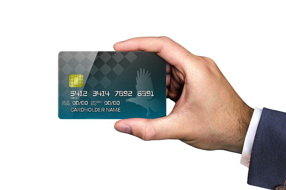 Businessman holding credit card mockup generator mockup
