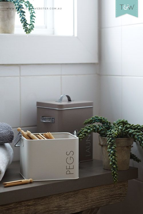 Create a consistent look in your laundry with matching containers for pegs, powder etc.