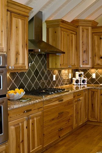 Hickory Cabinets With Brown Tile Backsplash Mounted In