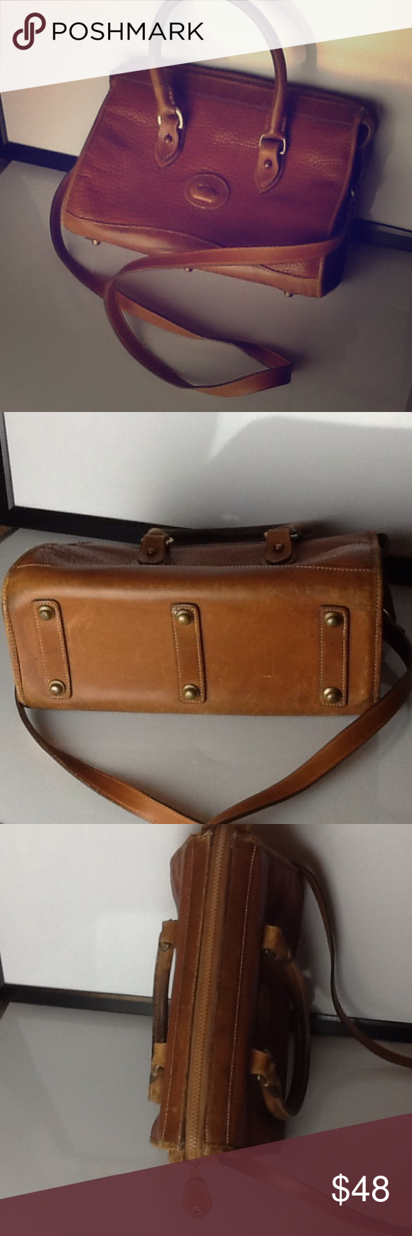 Vintage British Tan Dooney & Bourke bag All is fair in love and wear. This little beauty has signs of wear and the inside has lost a few ink pen battles. However, the bag is solid and only you and maybe someone invading your personal space will really notice any damage. (Shoulder strap included). Dooney & Bourke Bags