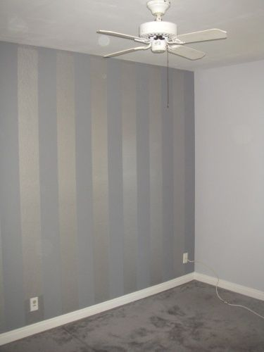 Light Grey Walls W Flat Finish Accented By A Metallic Silver And