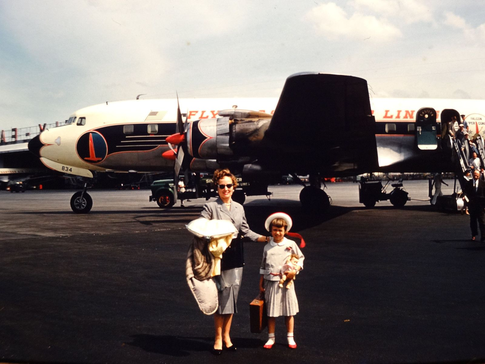 Slide Tourists on the tarmac • 1960s Italy travel