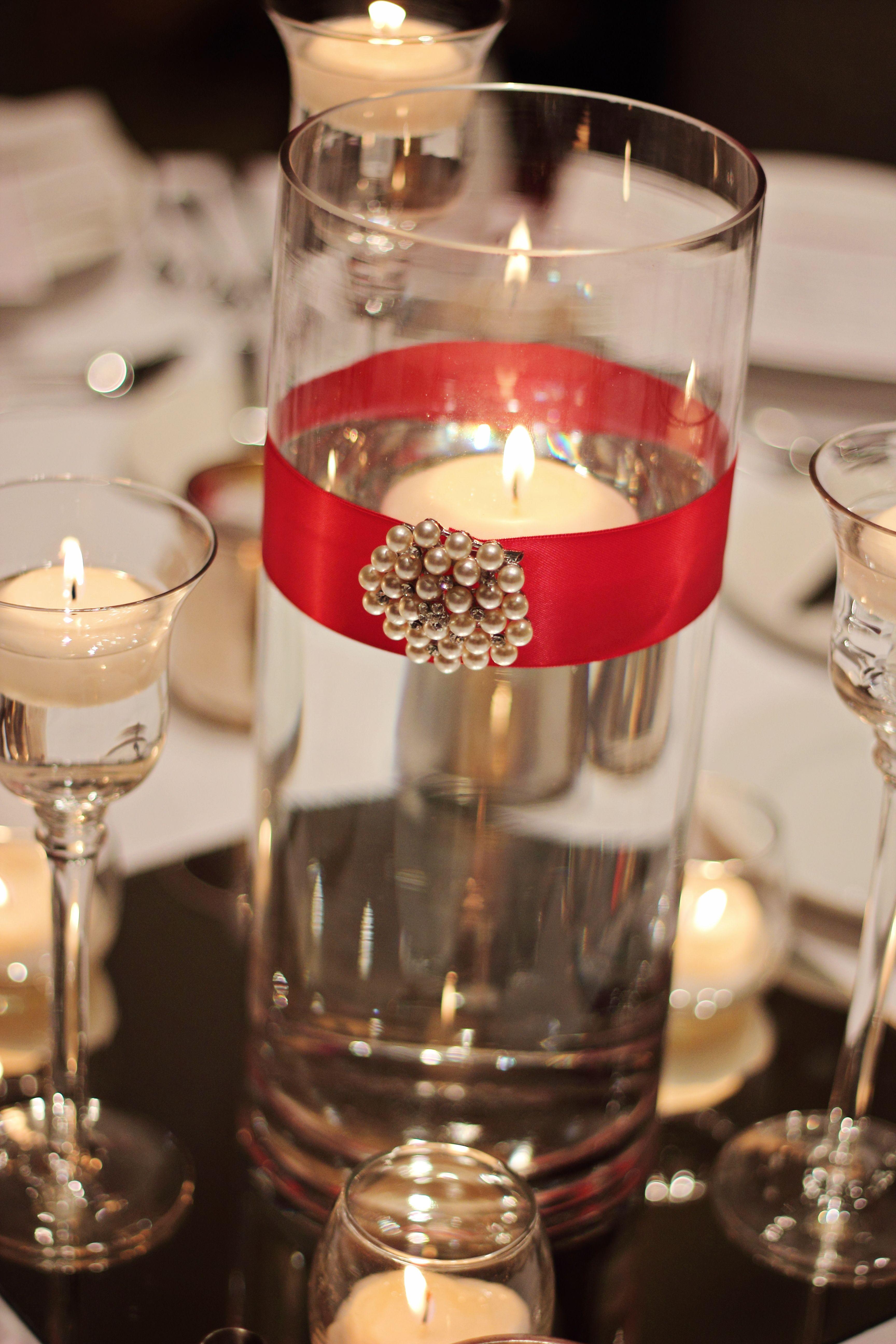 Wedding decorations red  Candle centerpiece  b u l wedding ideas  Pinterest  Centerpieces